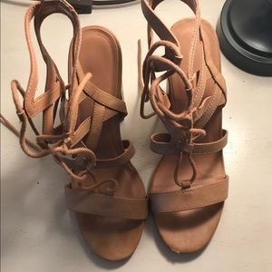 Shoes - Lace up tan heels.